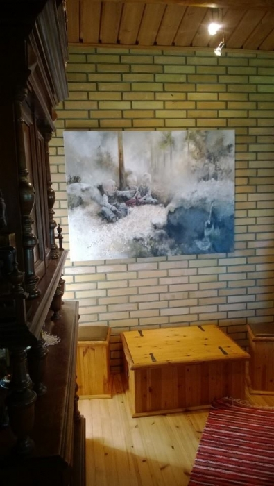 Taiteilija Netta Tiitisen teos Pekkalan seinällä.