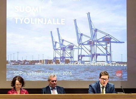 SDP esitteli oman vaihtoehtopaperinsa tällä viikolla - infon taustakuvana oli seisahtanut satama.